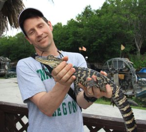 Holding a baby gator