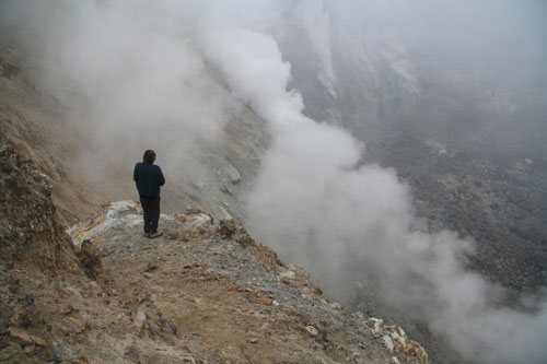 Looking into the abyss at top of Mutnovsky Volcano crater