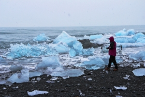 Valerie Walking Along the Iceberg-Covered Beach